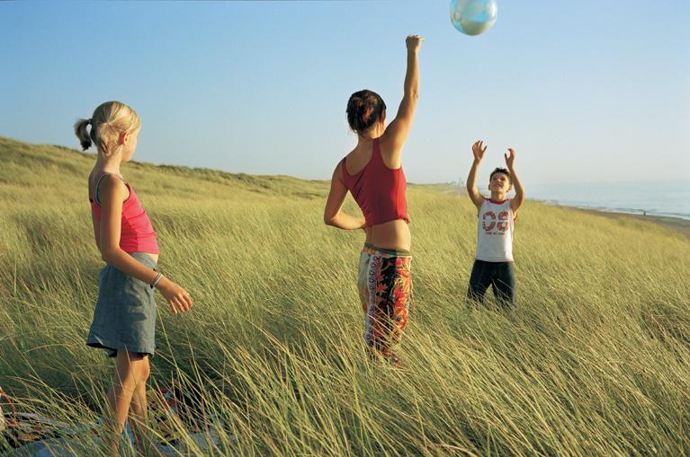 kids playing in the dunes