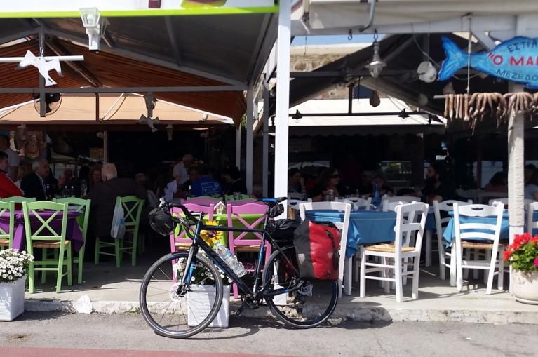 Bike parked in front of a restaurant in Evia