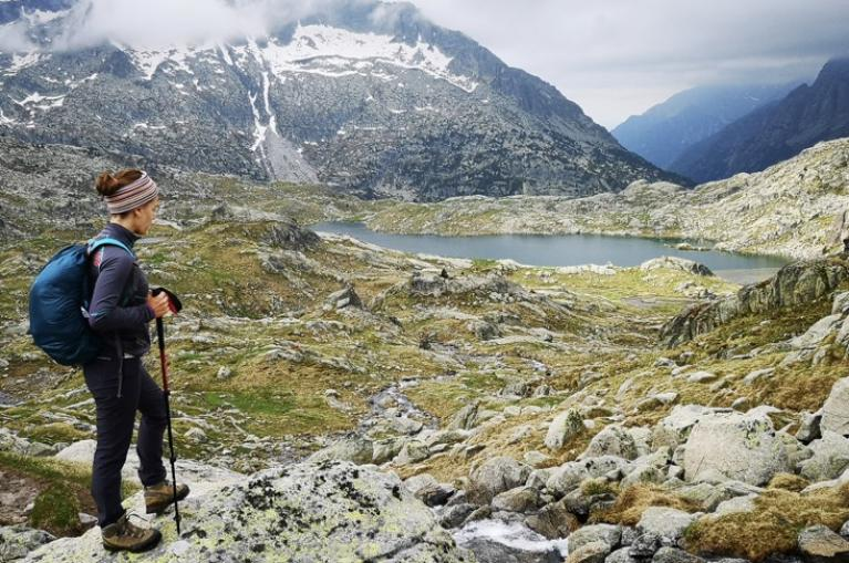 Hiker around lakes in Aigües Tortes