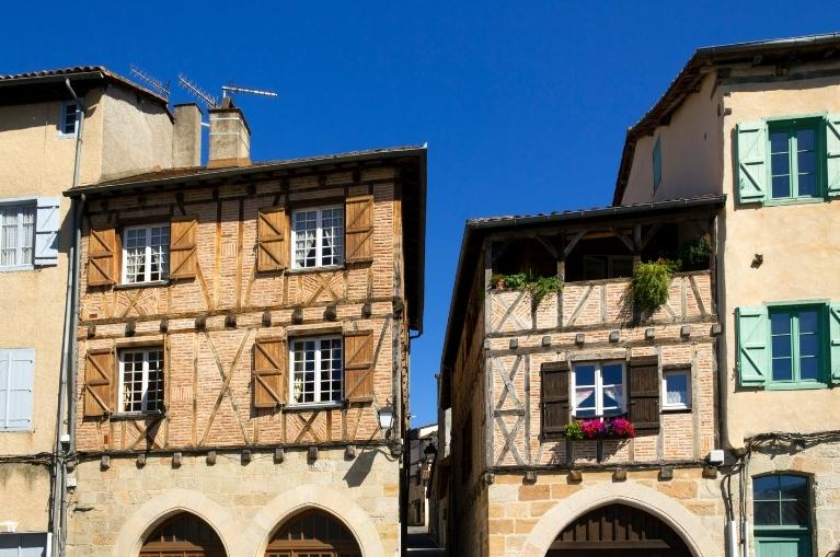 Quaint old buildings with colourful shutters in the streets and squares of Figeac
