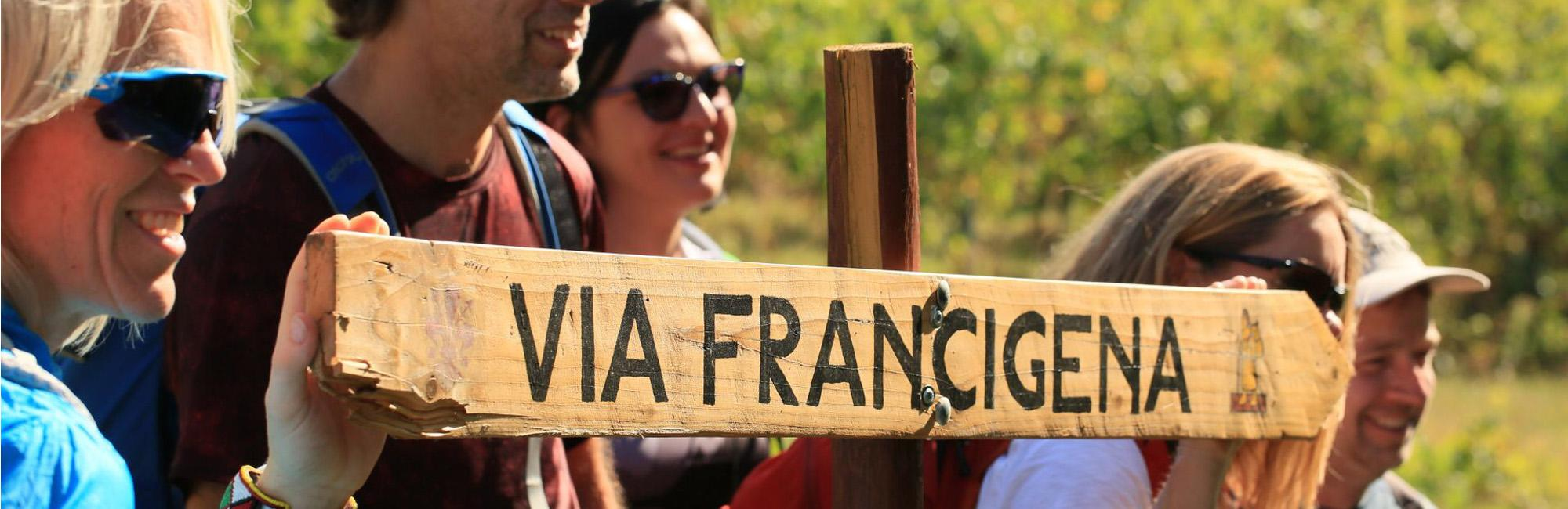 Pilgrims with a signal of Via Francigena