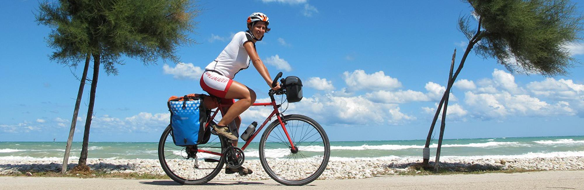 Cyclist on the coast of apulia
