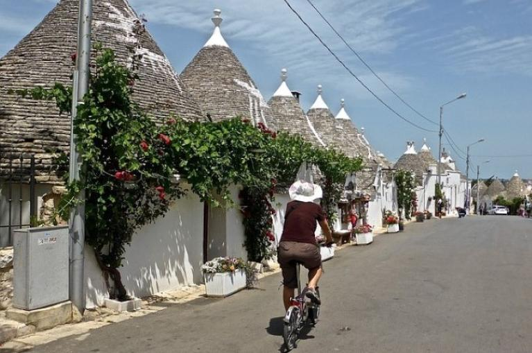 Cyclist in Alberobello