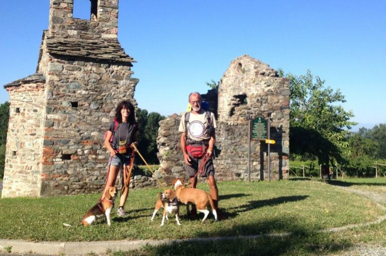 Pilgrims with dog in Via Francigena