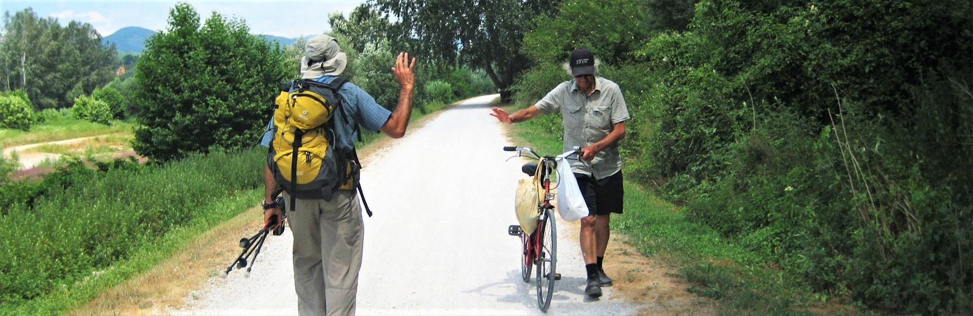 pilgrims waving at the Via Francigena